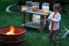 smore's at a wedding!!! Sooooo doing this! (But, I would take the long tie off of the Ring Bearer- it's an accident waiting to happen!)