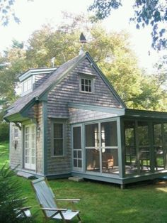 "Nice little enclosed porch- a pseudo ""conservatory"". Nice little meal area- imagine at night in summer, with lanterns all around outside. Cicadas chirping and some light refreshing drink- or a cuppa."