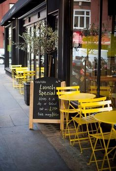Fermob Bistro Sets are great for sidewalk cafés. Bright and cheery, the Honey tables and chairs add a pop of color.