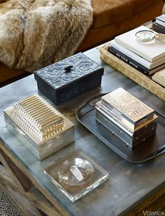Chic coffee table decor. Silver and wood car Ed boxes. Basket tray. Books. Veranda.