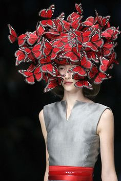 Butterfly hat by Alexander Mcqueen. There is nothing wrong with wearing butterflies in your hair. But when it starts to look like an orgy ball you've gone too far.