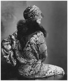 Edward Steichen Model wearing a black tulle headdress by Suzanne Talbot and a brocade coat with black fox collar1925