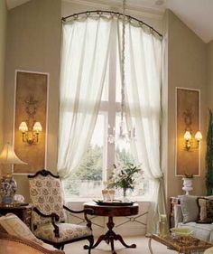 You need window treatments, unless you don't mind waving to your neighbor in your pajamas. But if you have tall windows, what options are there? More from my siteNew Kitchen Window Dressing Ideas Design IdeasChambres. Home, Windows And Doors, Arched Windows, Arched Window Coverings, Curved Curtain Rods, Window Design, French Door Window Treatments, Curtains For Arched Windows, Tall Windows