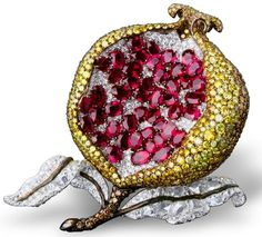 Michelle Ong    Simply stunning pomegranate clip with white, fancy yellow and brown diamond in platinum and yellow gold. Picture c/o The Jewellery Editor.