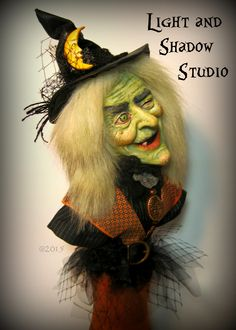 A painted and sculpted witch by artist Tammy Strum of Light and Shadow Studio