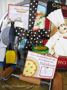 Just like the endless combinations of pizza toppings there are endless combinations of items that can be used for this pizza gift.  Some suggestions are:    Pizza Pan or Stone  Pizza Cutter  Rolling Pin  Dish Towels  Pizza Sauce  Seasonings  Basting Brush  Cutting Board/ Rolling Mat  Cookbook
