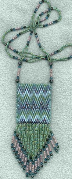 Aqua-green amulet purse by Suzanne Siegel