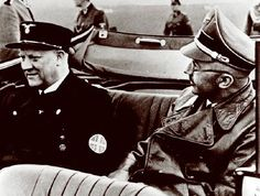 """Vidkun Quisling (left), the man whose very name came to mean """"traitorous collaborator,"""" rides with SS head Heinrich Himmler, likely during Quisling's visit to see Adolf Hitler in December 1939. Quisling was a Norwegian military officer who helped form a Fascist political party in 1933, with himself as Fører (leader, comparable to Führer)."""