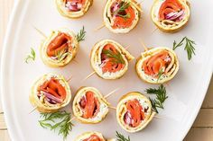 Smoked salmon and cream cheese rolls 1 cup light cream cheese 3 teaspoons finely chopped fresh dill 1 teaspoons finely grated lemon rind packet frozen French-style crepes, thawed 8 slices smoked salmon 1 small red onion, halved, thinly sliced Gourmet Desserts, Seafood Appetizers, Appetizer Dips, Cream Cheese Rolls Recipe, Salmon Canapes, Smoked Salmon Cream Cheese, Christmas Finger Foods, Savory Crepes, Salads