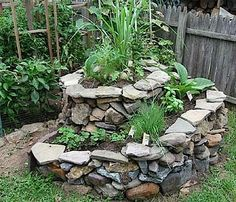 DIY Cozy Home - How To Make A Sprial Herb Garden also here : http://www.dirtiestkidintheworld.com/2012/02/progression-of-herb-spiral.html