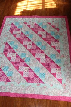 Beautiful Traditional quilt for baby girl. Very large baby quilt in petty pink florals and aqua and turquoise blue. This would make a wonderful newborn gift or baby shower gift. The quilt can be personalized also. Please allow 6-8 weeks for completion. | Shop this product here: http://spreesy.com/DollyWollySewing/184 | Shop all of our products at http://spreesy.com/DollyWollySewing    | Pinterest selling powered by Spreesy.com