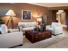 Brown family room with light tan furniture and soft lighting.  Beautiful.  Olde Naples - Melinda Gunther Naples Realtor