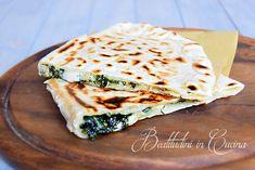 Cassone romagnolo alle erbe di campo.  Italian piadina filled with wild herbs #italianfood #streetfood #recipe #ricetta