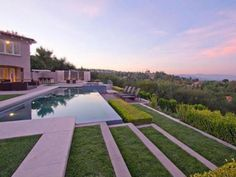 Dwayne Johnson Dwayne The Rock Johnson recently sold his custom-built contemporary home in Hidden Hills, Calif. Perched at the edge of the property, an infinity pool and spa overlooks endless vistas of mountains and valley lights. Other outdoor amenities include spacious patios, a barbecue center and a stacked-stone waterfall just past the gated driveway.