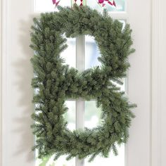 Monogrammed wreath made using faux evergreen boughs