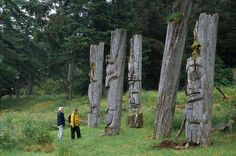 Weathered totem poles on Haida Gwaii, BC. Experience the living culture of the Haida while staying at Haida House!