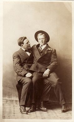 1910 - Two men share some quality time together.