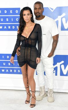 """The reality star donned a sheer black curve-hugging sheath alongside the rapper, who opted for a white t-shirt with """"Famous"""" imprinted on it over matching jeans."""