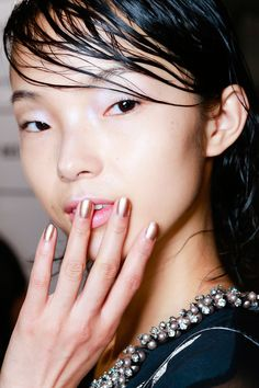 3.1 Phillip Lim Spring 2014 The futuristic, ethereal makeup  had a gorgeous, holographic texture to eyes and lips. The entire face was glowing and paired beautifully with a wet-looking side-swept 'do. Sheer, pearlized purple and blue tones on the eyes and lips created a very soft, youthful look
