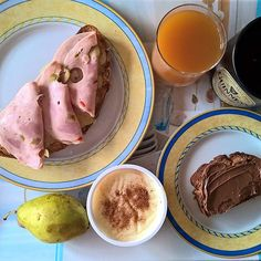 Special #tgif breakfast: A grilled sourdough slice topped with melted mature cheddar and Greek salami with green olives, a slice of banana bread topped with milk chocolate spread, a milk pudding from @stamou_milk_products and a juicy pear. #thenewbreakfasteverydayproject #livingmylifemyway
