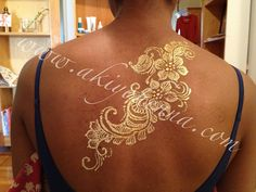 Gold henna on the back