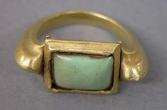 Stirrup-shaped Ring with Green Stone in Square Mount Period: Central Javanese period Date: Second half of the 8th–second half of the 10th century Culture: Indonesia (Java)
