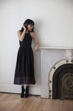 """Washed black linenhalter neck dress with fitted bodice. Full gathered skirt with wide charcoal linen band at hem. Zipper down back. 100% linen. Model wears size small and is 5'8"""" tall. Hand wash or machine wash cool, hang to dry or tumble dry cool. *This item is made to order and ships 2-3 weeks from order date. Antique Clothing, Gathered Skirt, Black Linen, Modern Outfits, Linen Dresses, Fitted Bodice, Charcoal, High Neck Dress, Stylish"""