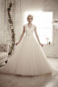 Balletts Bridal - 22881 - Wedding Gown by Jacquelin Bridals Canada - Illusion Tank/cap sleeve lace bodice with Satin Belt at wasit Tulle Skirt with Illusion High Lace Back