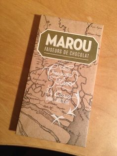 marou faiseurs de chocolat. chocolate bar packaging with a map and white hand writing.