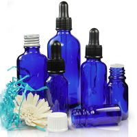 Blue glass dropper bottles. www.ampulla.co.uk, perfect for all your essential oils