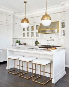 Hicks Extra Large Pendants by Thomas O'Brien Stunning transitional kitchen with white cabinets, marble countertops and a mixed metal range hood. Lighting: Hicks Extra Large Pendants by Thomas O'Brien in Hand-Rubbed Antique Brass with White Glass. White Marble Kitchen, Gold Kitchen, White Kitchen Cabinets, Home Decor Kitchen, Interior Design Kitchen, Kitchen Furniture, New Kitchen, Home Kitchens, Kitchen Dining