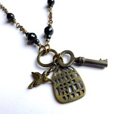 .vintage key necklace with bird and birdcage.     t
