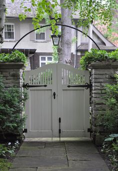 Garden gate. Clean & neat. Squeezed between two wall sides. Mind the arch with a lantern