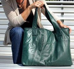 """Handbag designer Sandy Philpott of Uptown Redesigns creates one of a kind purses, totes and handbags from out-of-style leather coats and other materials, including a line of made-to-order """"Military Tent Totes"""" utilizing the canvas from US Army tents."""