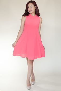 Cool As Coral Dress   This bright coral dress has summer written all over it! With a flattering swing dress silhouette and a darling mod inspired collar, this dress is both comfy and stylish.   Idol Collective