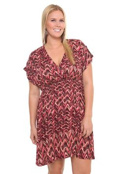 Zigzag Surplice Challis Dress  Colorful and flirty, a zigzag print, blushing in shades of red, patterns this soft and stylish 70s-inspired dress. The bodice features a flattering faux-wrap silhouette and is shirred along the figure-defining high waist. Features folded short sleeves and a V-neckline. $64.50   Sku# 555614