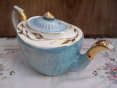 Beautiful antique powder blue Gibsons teapot, made in England. C. 1891-1921. It has tea staining in the spout and on the inside. It has a chip on the inside rim of the lid, across the hook. There is wear to the gold gilt and the powder blue lustre. But other than that in good