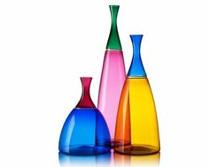 """Bold hand blown glass vessels boast strong curves and smart color combinations.  The two-toned glass vases are shaped using the Venetian """"incalmo"""" technique: on two pipes and joined at the seam during the glassblowing process.  A detailed 24k gold leaf wrap accentuates the seam.  Choose from tall, medium or short and combine sizes to create a landscape of color and form."""