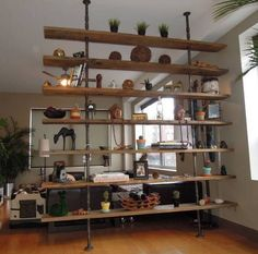 book case pipes wood | Bookcase made of steel gas piping and reclaimed wood.