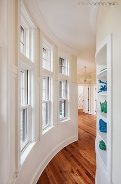 House of Turquoise: Bowley Builders - A CURVED HALLWAY WOULD BE A GREAT UNIQUE FEATURE TO HAVE IN MY FUTURE DREAM HOME.