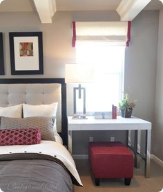 I like the idea of having a desk/ottoman as a bedside table- double duty!