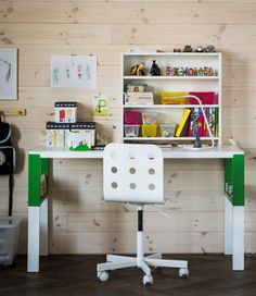 An organized study area for a child that uses a white and green PÅHL desk, a desk shelf unit and see-through boxes with lids to easily store small stuff