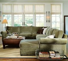 Sectional sofa and window shades.