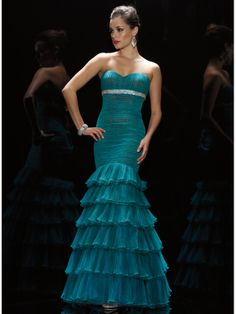 Gorgeous tulle Alyce Designs pageant dress 5400. Contrasting the hues make you stand out with a perfect look. A mermaid silhouette is finely ruched contrasting two colors adding trend to the dress. A sparkling empire belt highlights the strapless sweetheart neck. The tiered skirt amazingly ruffles to the floor in a festive way. Accessorize this dress with silver details. Available in Teal/Chocolate, Black Solid, Light Pink Solid, Navy Turquoise and White Solid.