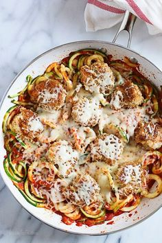 Baked Shrimp Parmesan over Zucchini Noodles – an easy, light and delicious shrimp dish made in under 30 minutes! I love shrimp parmesan and make it often at home because it's so much healthier to make it yourself. Rather than frying the shrimp like you'd get from a restaurant, I bake them in the oven until golden. I've been using Tuttorosso tomatoes for years – if you've been following me from the beginning, you probably already know that they're my crushed tomato of choic...