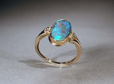 Black Opal Ring;; I would love to get something like this for a promise ring :)