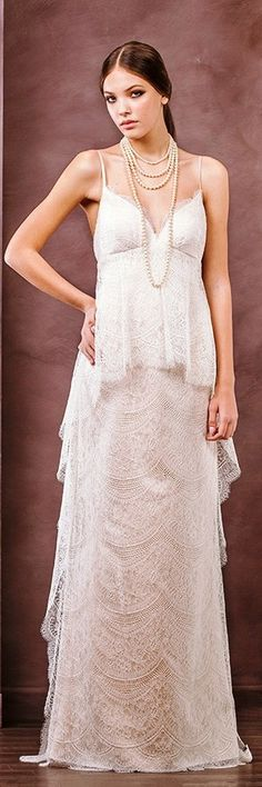 """3e796c775ea9 Divine Atelier's 2015 bridal collection, """"Nostalgia"""" was inspired by the  but while pearl and feather accessories provide the fitting framing for"""