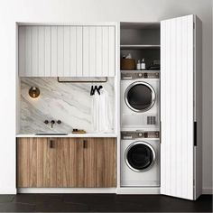 Designing the ultimate laundry, all the tips and tricks you need! Laundry goals! Just love the timber panel cabinetry and large marble splashback