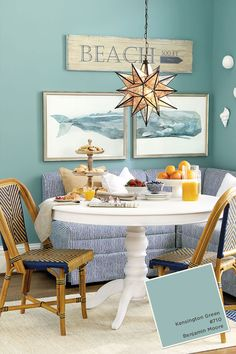 For a coastal banquette, we used Benjamin Moore's Kensington Blue, which perfectly matches or Whale Diptych Art piece.