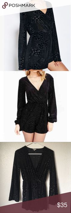 Ecote velvet textured romper from Urban Outfitters Gorgeous black velvet textured romper. Features long bell sleeves and flattering wrap style. Very flowing, flattering fit with stretch fabric. Like new condition. Urban Outfitters Pants Jumpsuits & Rompers